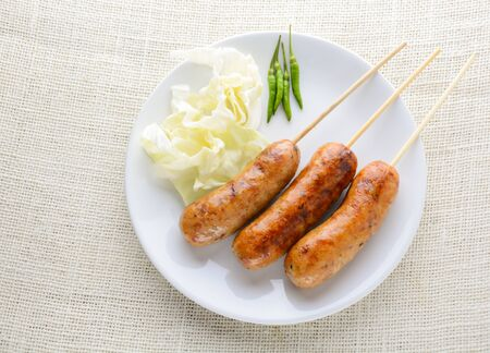 Thai Spicy Sausages, made from minced pork mixed with a variety of ingredients which makes it packed with flavour, and gives it a unique scent.
