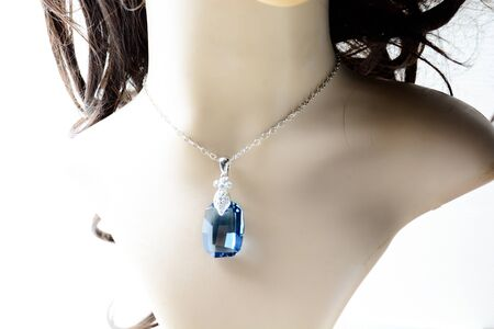 Crystal necklace on mannequin and on white background