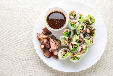 Fresh assorted Asian spring rolls with grilled pork, fresh vegetable. Healthy and delicious dish
