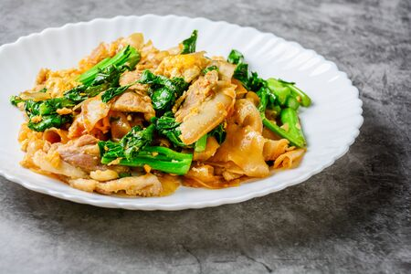 Stir-fried Fresh Rice-flour Noodles With Sliced Pork, Egg and Kale. Quick noodle stir-fry.