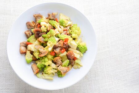 Stir fry Romanesco broccoli with crispy pork and chili, very healthy and delicious