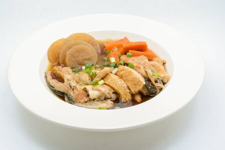 Salmon in soy source with vegetables, fish maw soup Stock Photo