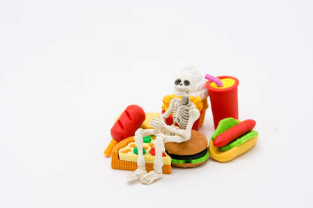 Skeleton and foods, enjoy eating until death with junk foods.