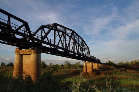 truss: Steel bridge crossover the river.Its a truss bridge for railway.