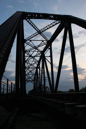 truss: Truss bridge for railway after sunset.It cross over the river.