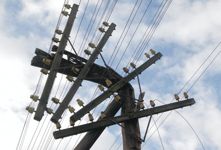 power pole: The old broken wooden telegraph column