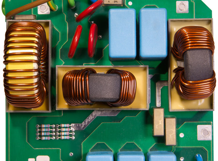 windings: Powerful electrical device on the circuit board Stock Photo