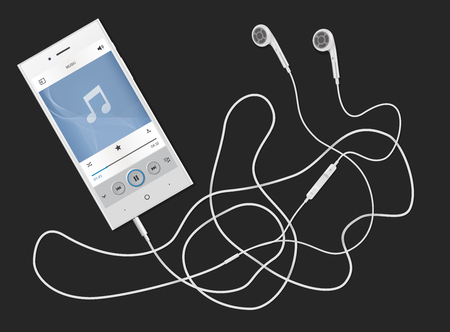 phone with the earphones lying on a table, on a black background