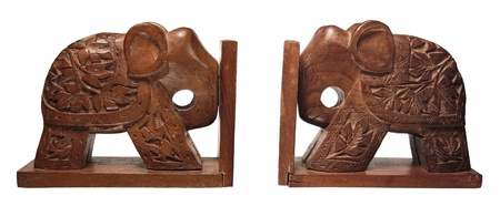 Two wooden elephants of a book-holder are on a white background