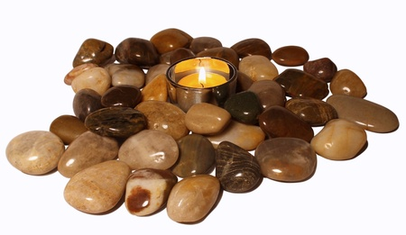 Candle and pebble on a white background Stock Photo