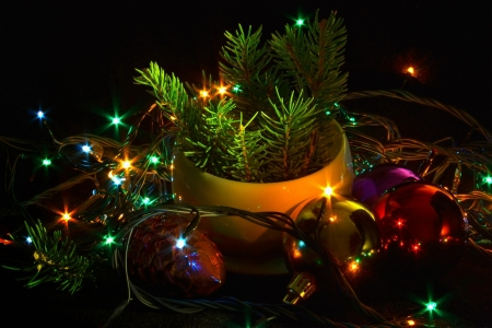 Fir-tree branches, Christmas tree decorations, bulbs to be on a black background