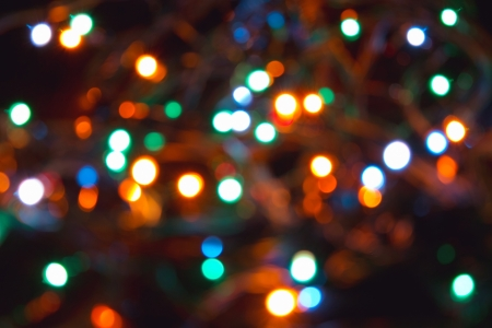 Christmas garland on a tree, out of focus the image, textura  Stock Photo