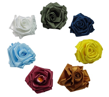 Seven roses from color silk are on a white background
