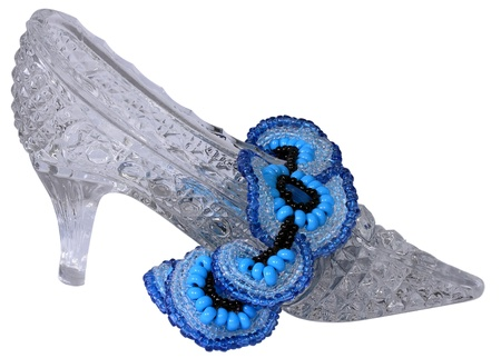 The crystal shoe and blue necklace is isolated on a white background