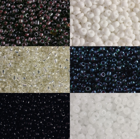 Three options of black and three   options of white beads are   photographed very largely