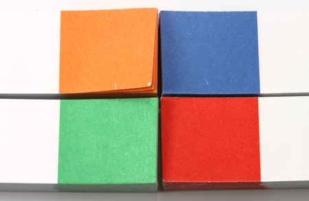 Four sets of sticky pieces of paper for notes of green, blue, red and orange