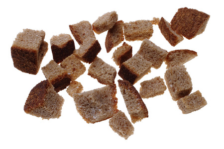 Photo of small dry slices of rye bread with salt for broth on a white  Stock Photo