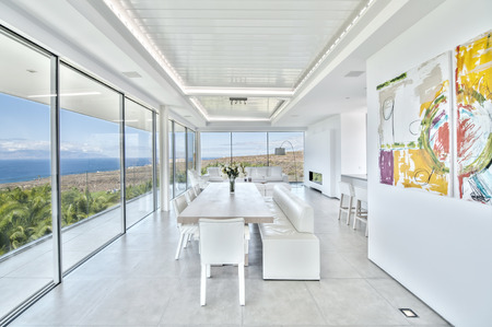 huge: White living room in the modern villa with sea view