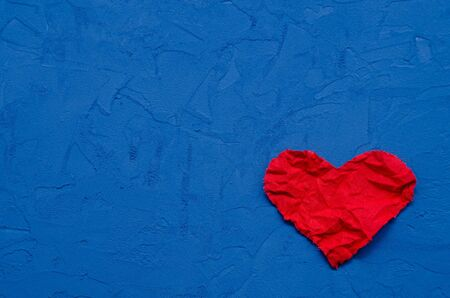 The concept of zero waste. environmentally friendly rumpled heart of flax on a blue background. broken heart. lost love. broken hopes and dreams. layout for postcards with copy space