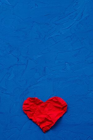 zero waste concept. environmentally friendly flax heart on a blue background. Congratulations on Valentine's Day, birthday or other holiday. vertical orientation blank for postcards
