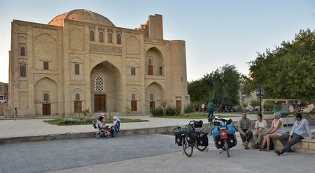 Bukhara, Uzbekistan - 05 August 2015: Foreign tourists and locals in the squares and streets of ancient Bukhara in Uzbekistan.