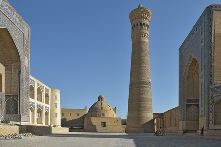 poi: Bukhara, Uzbekistan - 05 August 2015: Poi Kalon architectural ensemble, located at the foot of the Kalyan minaret. The complex consists of three buildings constructed in XII - XVI centuries.