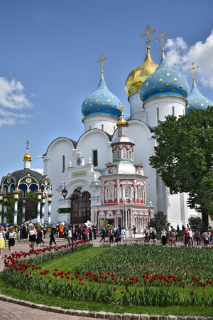 Sergiev Posad, Russia - may 28, 2016: many pilgrims and tourists gathered in the main square of the Cathedral of the Holy Trinity St. Sergius Lavra.