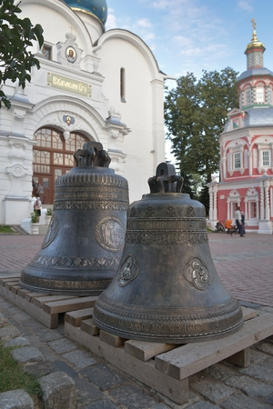 Sergiev Posad, Russia - August 29, 2015: Two bells on the Cathedral square in Holy Trinity St. Sergius Lavra. Sergiyev Posad is included into the Golden ring of Russia and is a pilgrimage center of the Christian world.