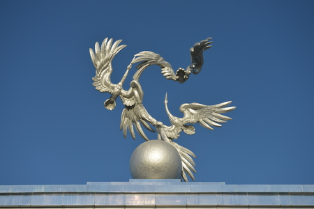 Sculpture of Storks as a symbol of peace in front of the main square (Mustakillik) to host celebrations and military parades in the days of special events and public holidays. Фото со стока - 62946892
