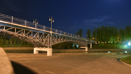 Pedestrian bridge across the river Anchor in Tashkent. This bridge was built in the Park The Museum of memory of repression victims