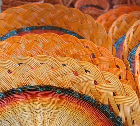 Colorful woven baskets from the branches.
