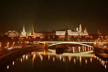 Night Kremlin on the banks of the river Moscow. Panorama of night city.
