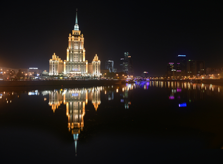 windlass: Moscow, Russia - 21 August 2016: The hotel Ukraine on the banks of the Moscow river. Night panorama of the big city. Editorial
