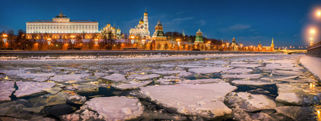 Ice floes on the Moscow River and the Kremlin in the evening illumination of lamps