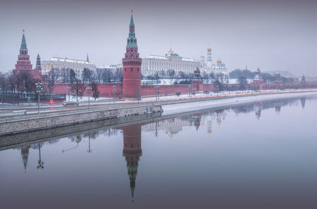 A gray haze over the winter Moscow Kremlin and its reflection in the Moscow River