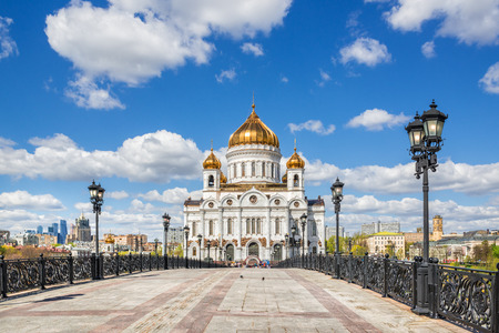 The Cathedral of Christ the Savior in Moscow under a blue sky with white clouds. Summer view from the Patriarchal bridge.