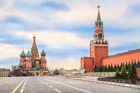 Spassky Tower and St. Basils Cathedral on Red Square in Moscow and the colorful sky without the sun