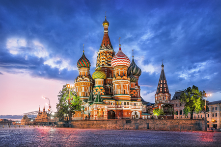 St. Basil's Cathedral in Moscow on Red Square on a summer evening and a blue cloud