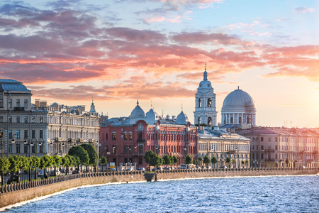 Ekaterininskaya church on the Makarova waterfront in St. Petersburg and the colorful sky in the setting sun