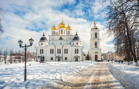 Assumption Cathedral with golden domes and bell tower in the Kremlin in Dmitrov on a winter frosty sunny day Editorial