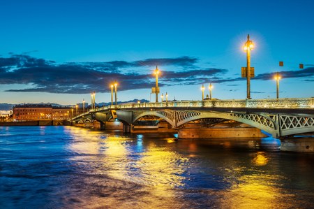 The Annunciation Bridge in St. Petersburg in the night illumination and the blue Neva River Stock Photo