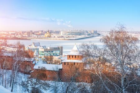 Ivanovskaya Tower of the Nizhny Novgorod Kremlin, view of the frozen Volga and the Alexander Nevsky Cathedral on the other side of a winter sunny day 版權商用圖片