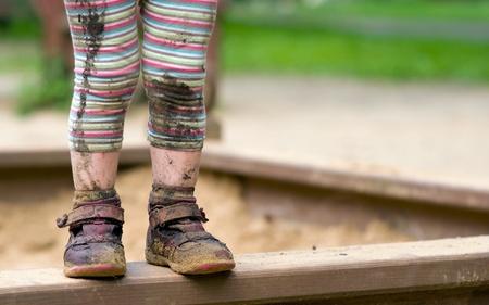 dirty feet: Little Girls Dirty Feet Standing on a Sandbox.