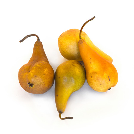 Yellow pears isolated on white background