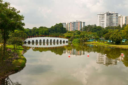 Lake and the bridge in the Chinese garden, Singapore photo
