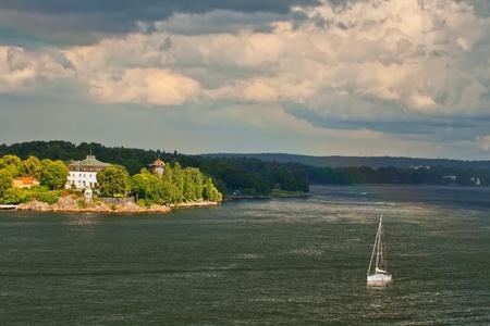 The small yacht near to coast of Baltic sea photo