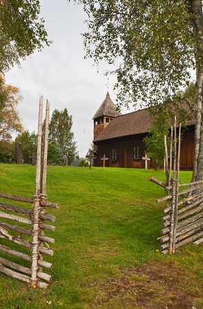 Ancient wooden Swedish church, rural landscape photo