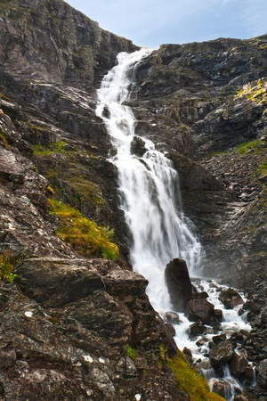 The big waterfall in mountains of Norway photo