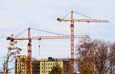 Tower cranes on the construction of the apartment house Stock Photo - 13646778