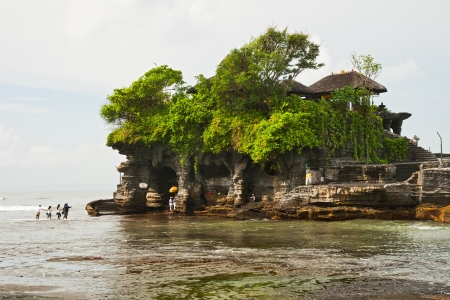 The Hindu temple on water Tanah Lot during low tide photo